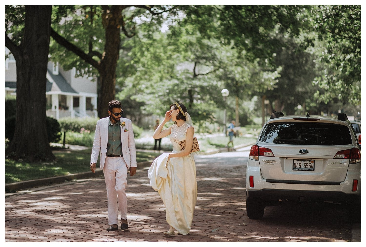 Champaign bride and groom walking