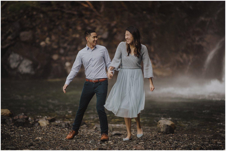 Couple having fun near Franklin Falls Snoqualmie Washington Engagement Session Seattle Wedding and Elopement Photographer Kyle Szeto