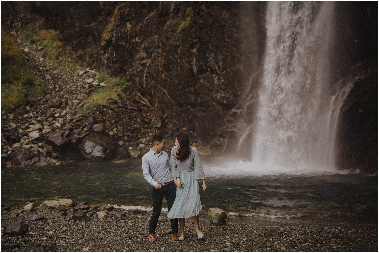 couple bumping hips at Franklin Falls Snoqualmie Washington Engagement Session Seattle Wedding and Elopement Photographer Kyle Szeto