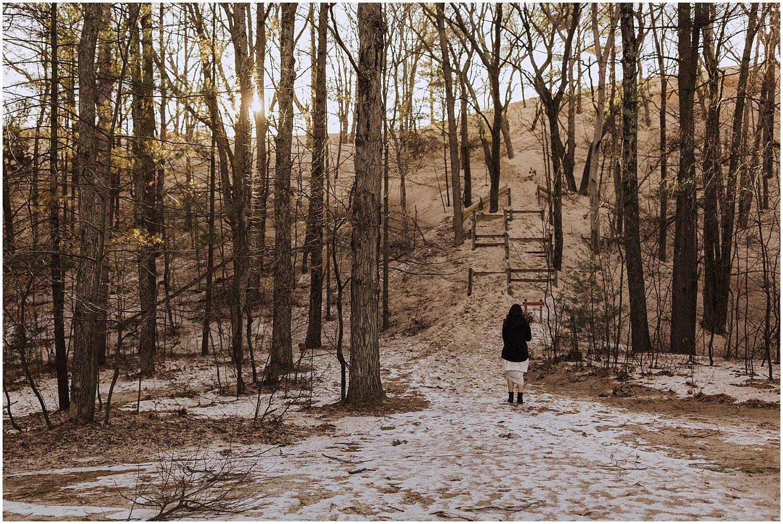 desert inspired elopement bride walking towards silver lake sand dunes michigan