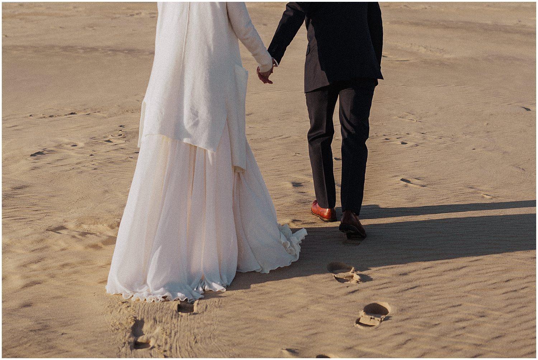 silver lake sand dunes michigan desert inspired elopement couple walking
