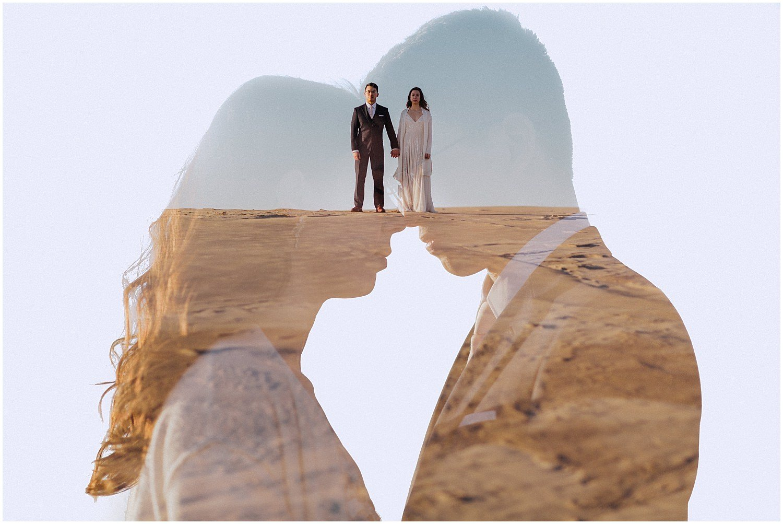 desert inspired elopement couple standing on top of sand dune