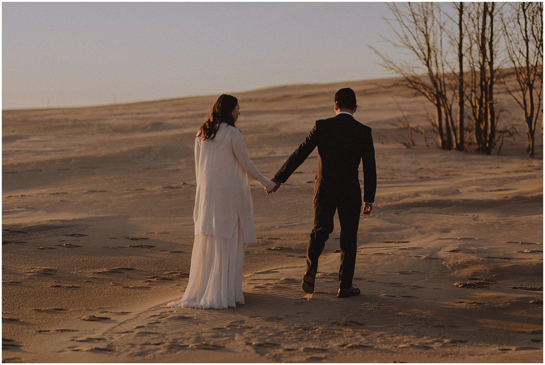 desert inspired elopement couple walking