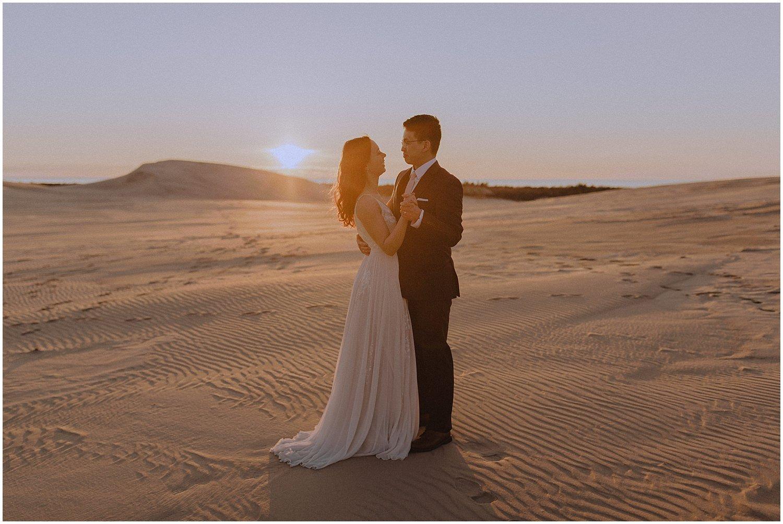 desert inspired elopement couple dancing as the sun sets