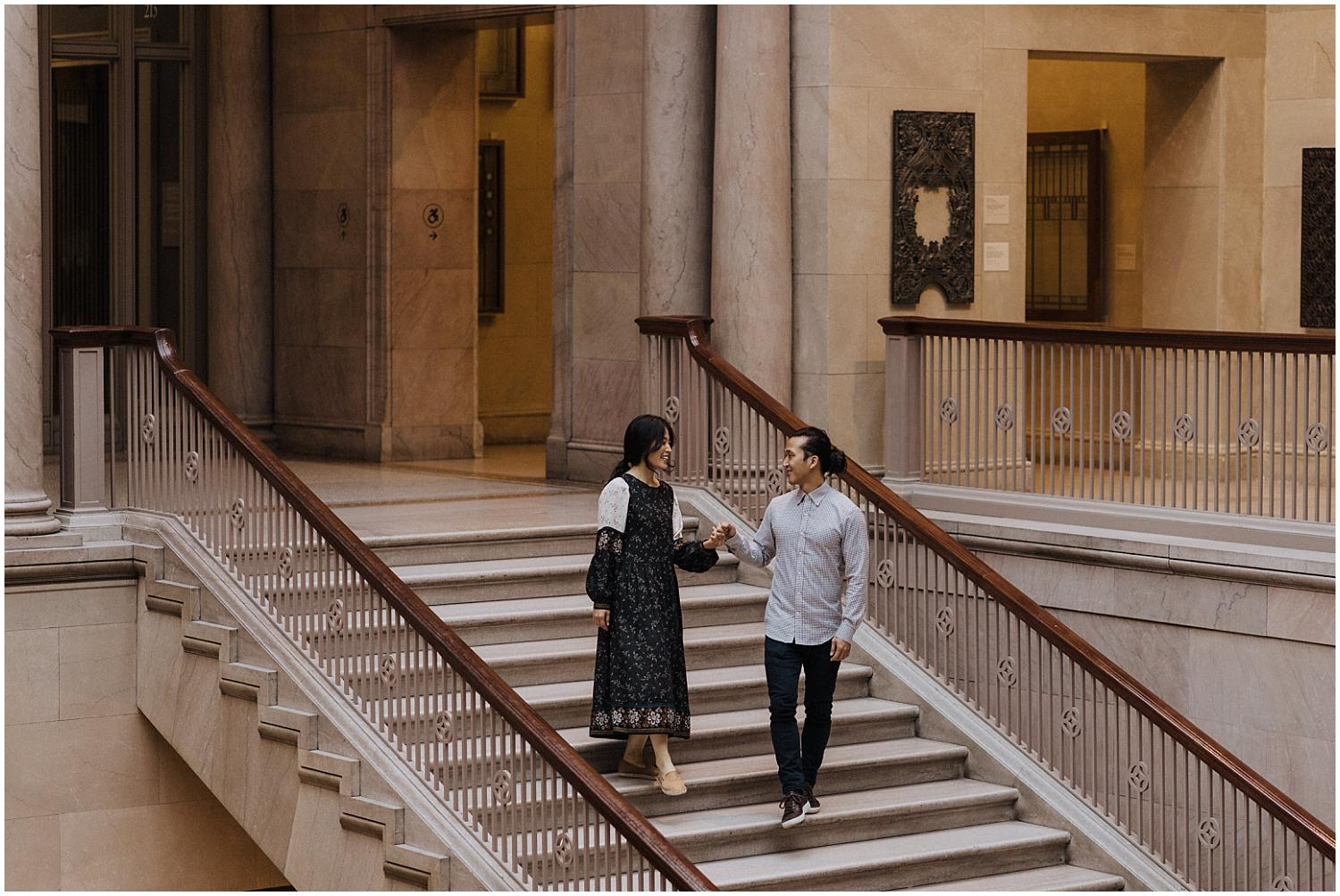 Couple walking down a grand staircase