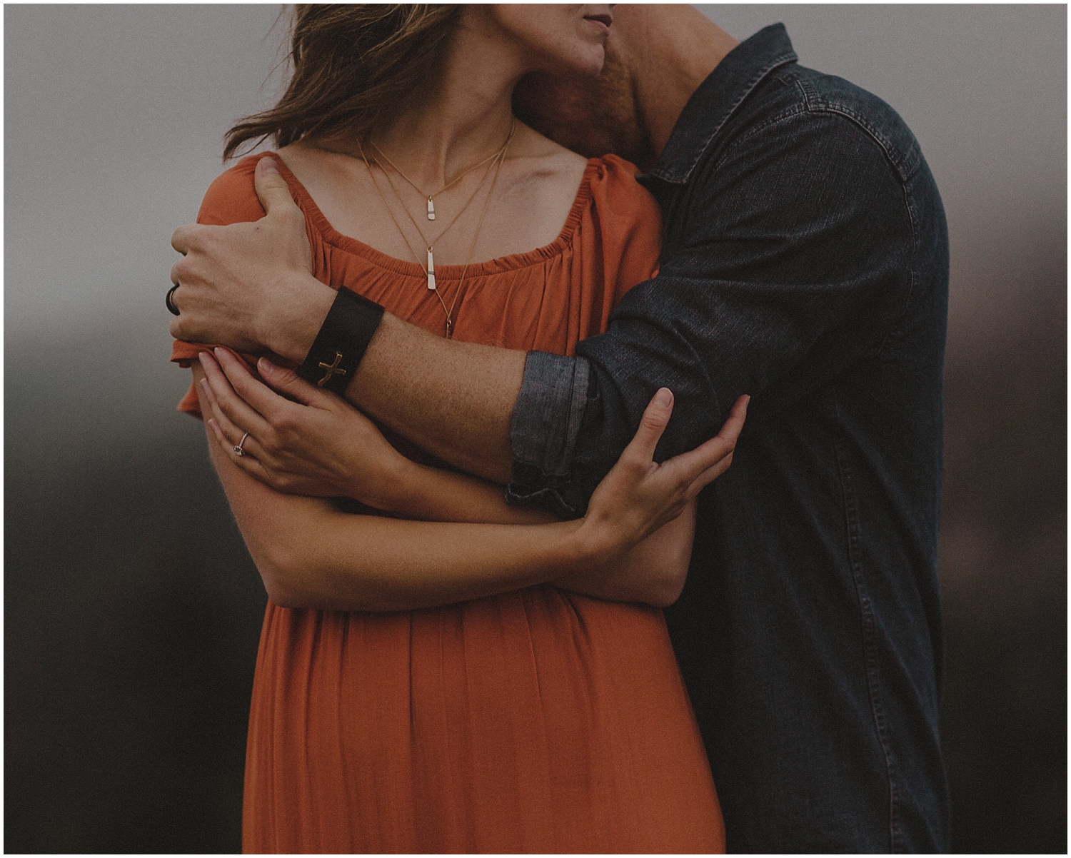 a couple wrapping their arms around each other