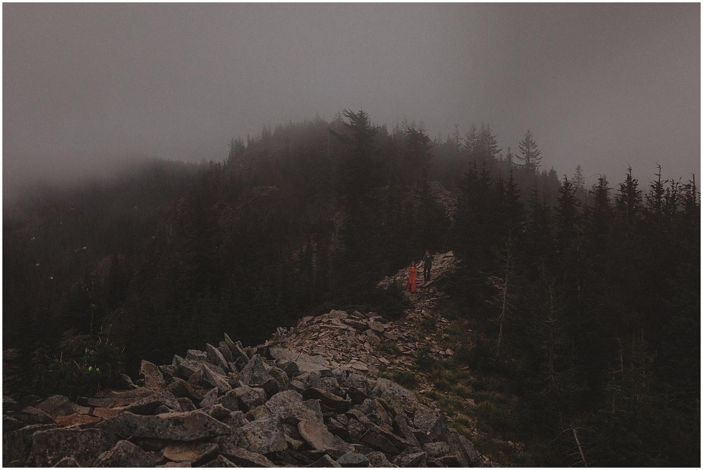 a couple walking along a mountain ridge