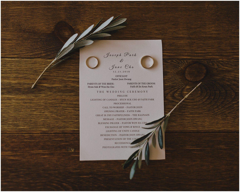 wedding day program with the wedding rings Chicago wedding photographer kyle szeto