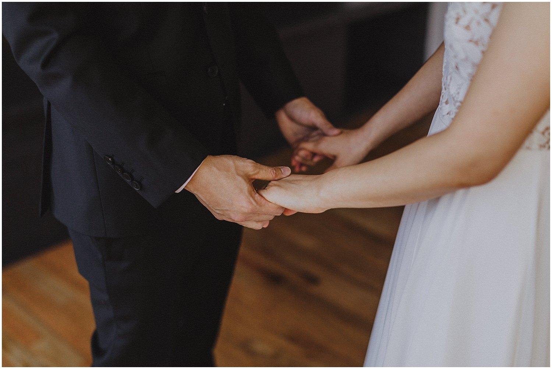 groom and bride holding hands Chicago wedding photographer kyle szeto