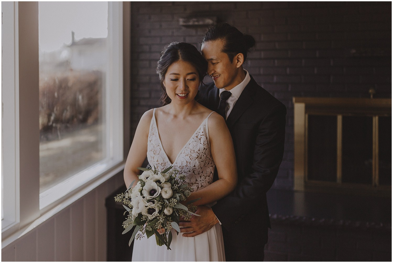 groom and bride holding each other Chicago wedding photographer kyle szeto