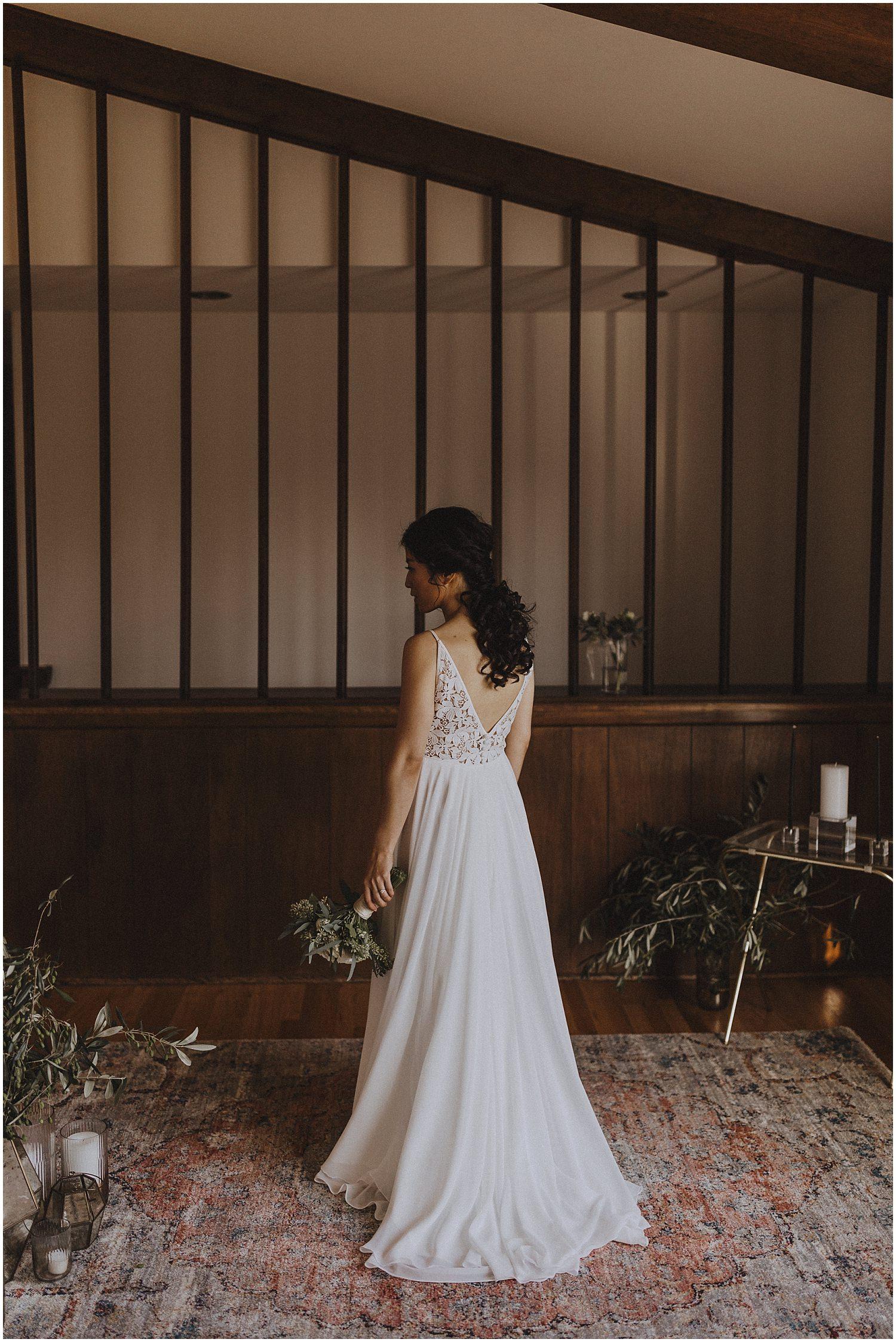 Bride standing with bouquet in her hands Chicago wedding photographer kyle szeto
