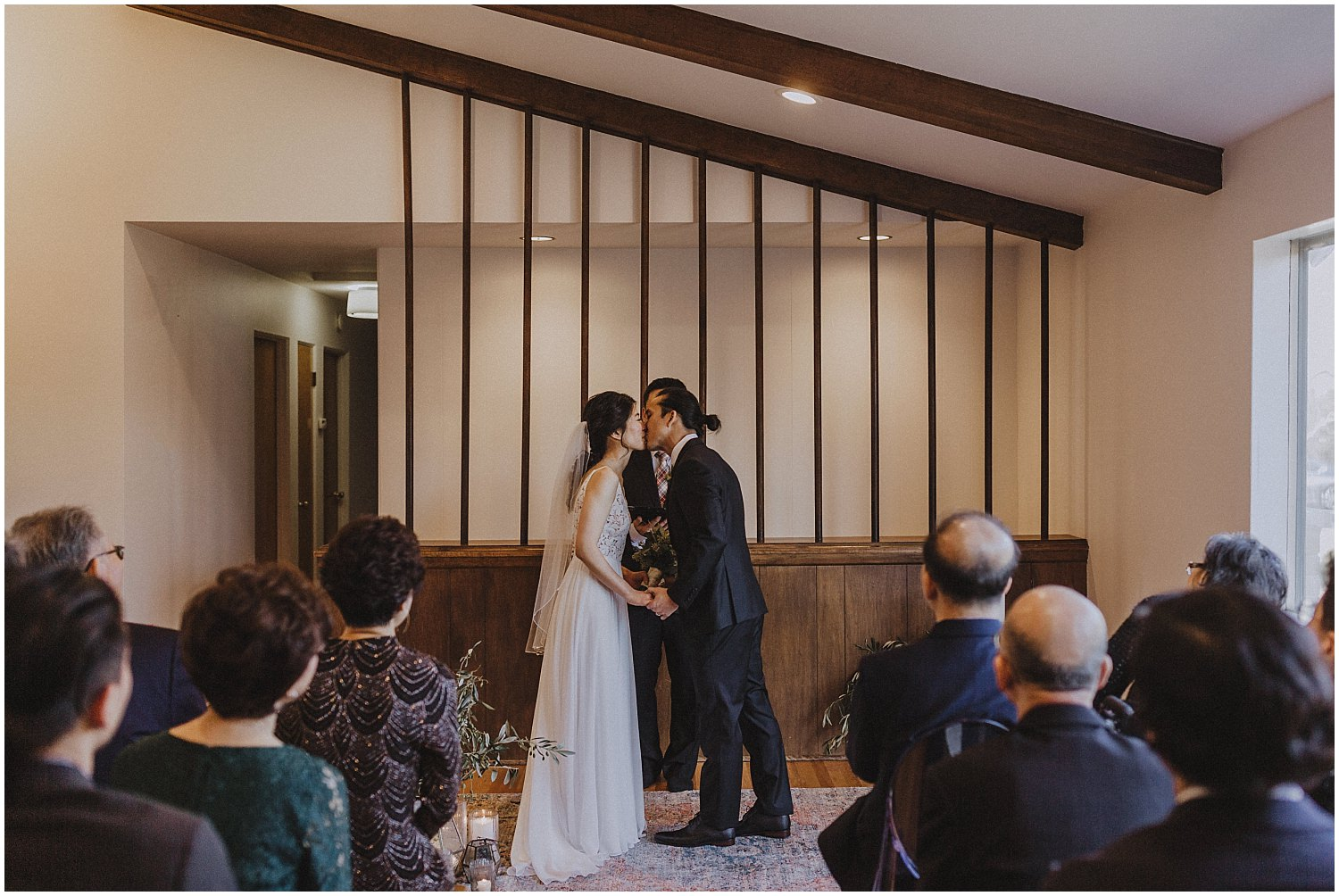 first kiss wedding at an in home wedding Chicago wedding photographer kyle szeto