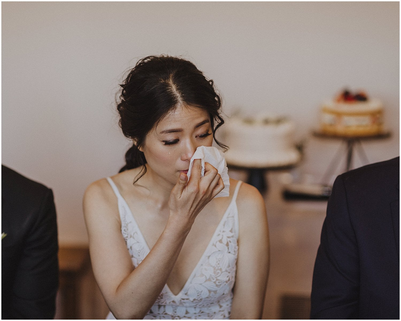 bride wiping away tears Chicago wedding photographer kyle szeto