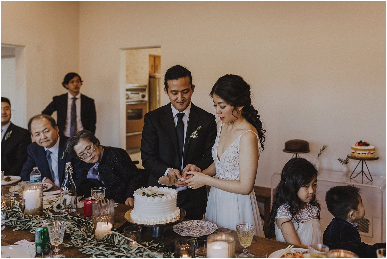 bride and groom cutting their wedding cake Chicago wedding photographer kyle szeto