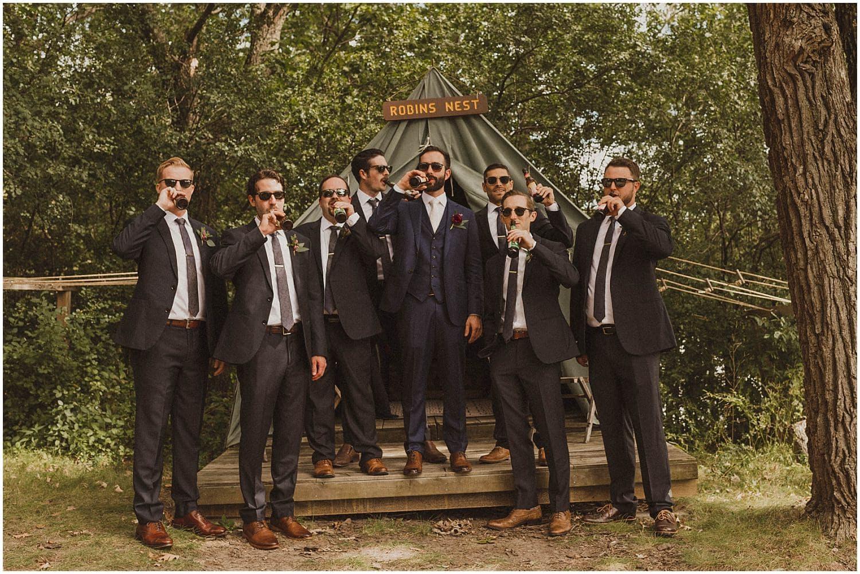 group of guys drinking at camp wandawega wedding wisconsin wedding elopement photographer kyle szeto