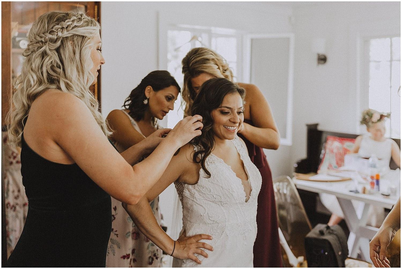bride finishing up getting dressed wisconsin wedding elopement photographer kyle szeto