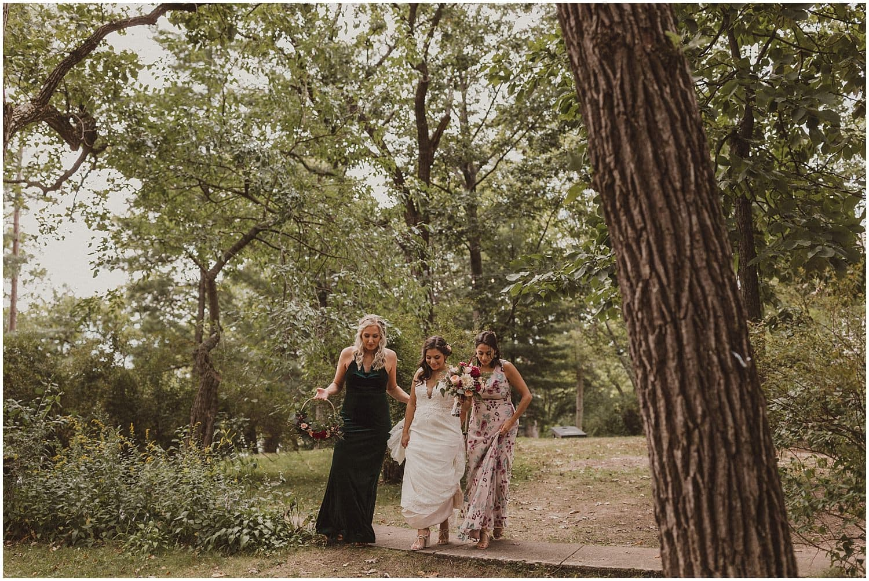 bride walking through the forest wisconsin wedding elopement photographer kyle szeto