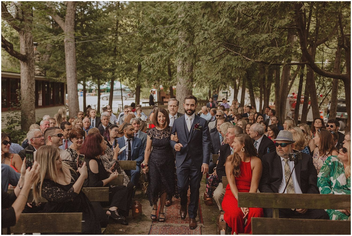 groom walking down the aisle with his parents wisconsin wedding elopement photographer kyle szeto