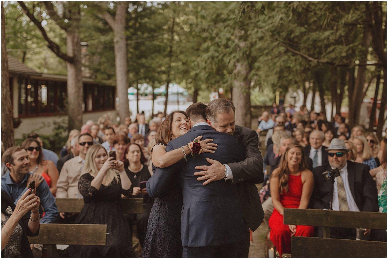 groom hugging his parents wisconsin wedding elopement photographer kyle szeto