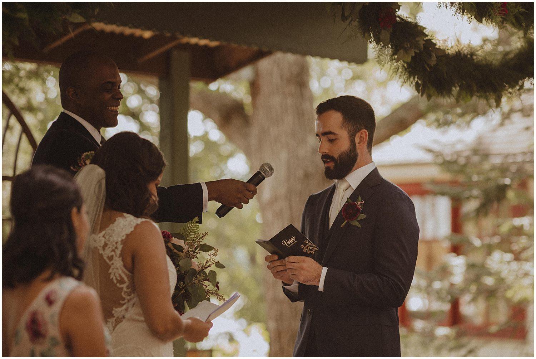 groom saying his vows wisconsin wedding elopement photographer kyle szeto