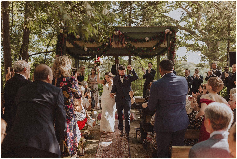 couple celebrating after wedding ceremony wisconsin wedding elopement photographer kyle szeto