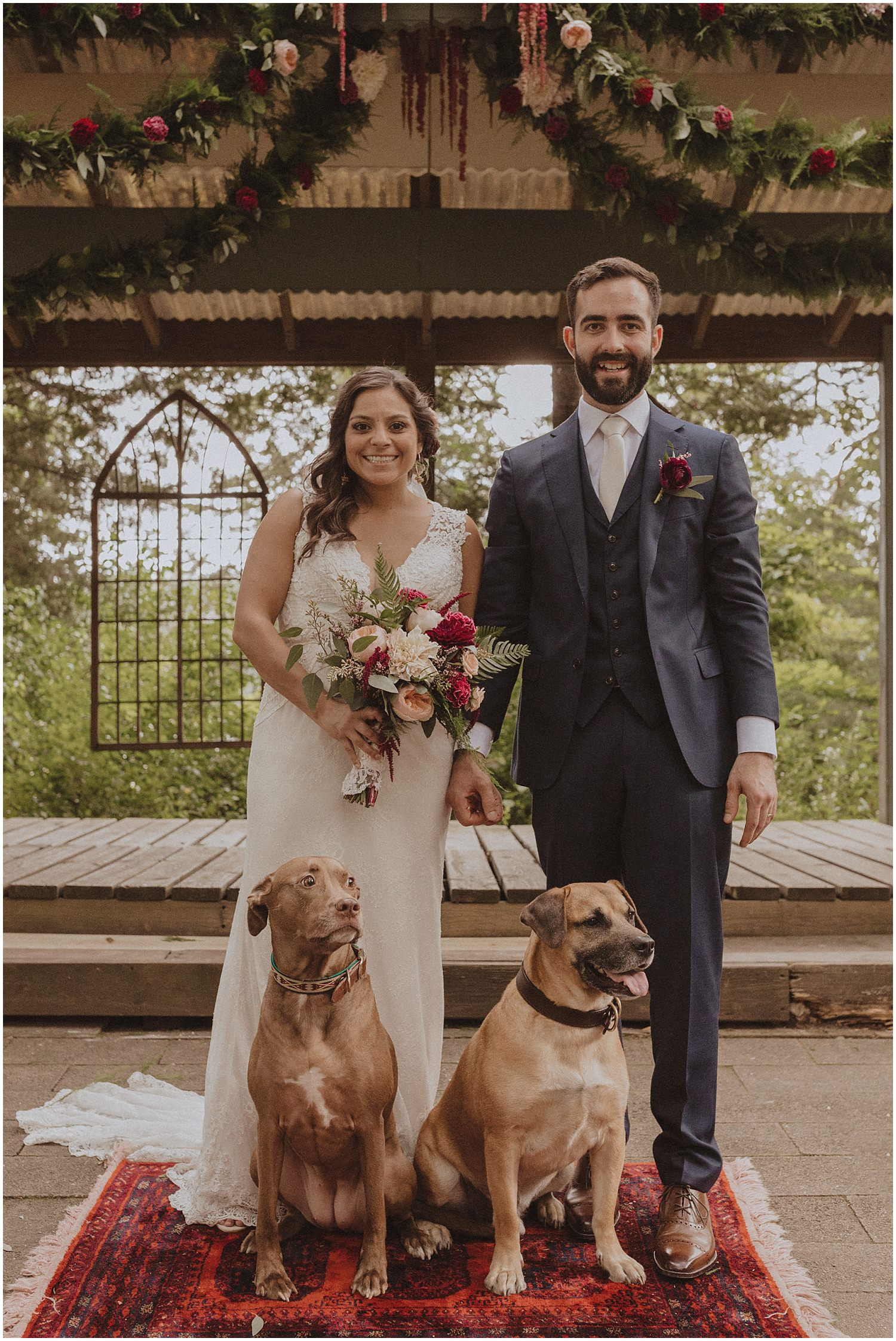 couple standing with their dogs wisconsin wedding elopement photographer kyle szeto
