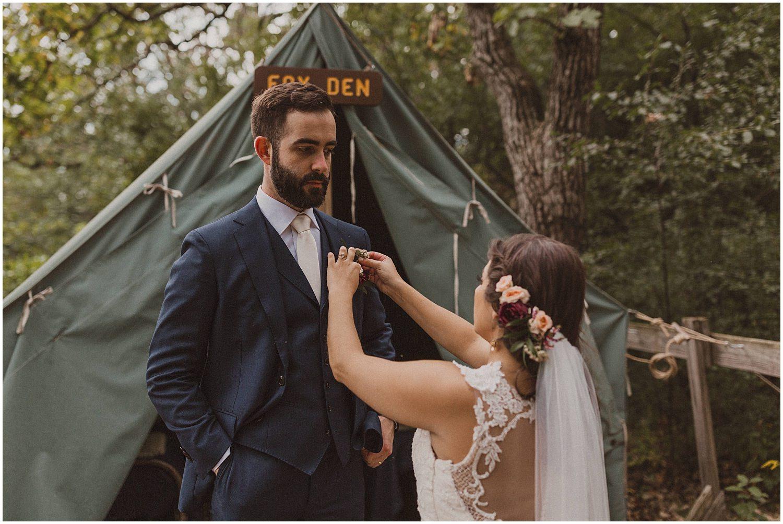 bride touching up the groom wisconsin wedding elopement photographer kyle szeto