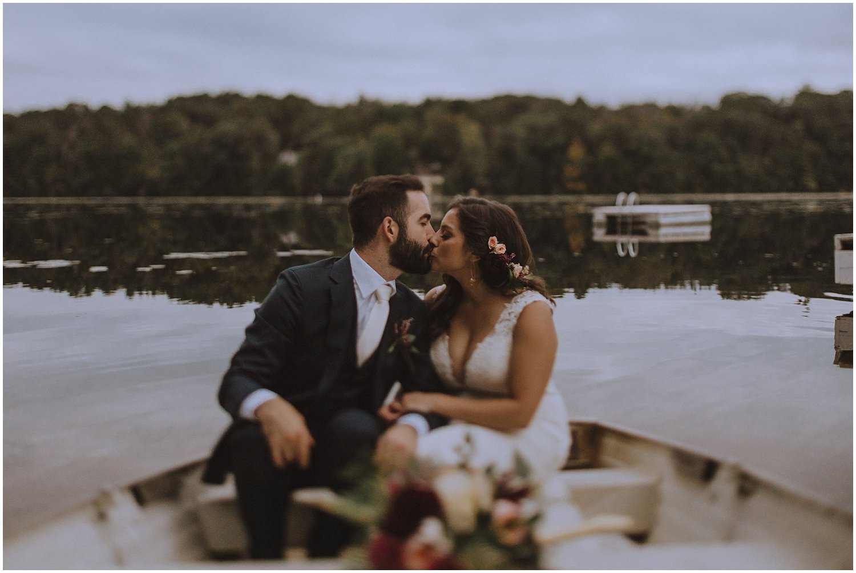 couple kissing in rowboat wisconsin wedding elopement photographer kyle szeto