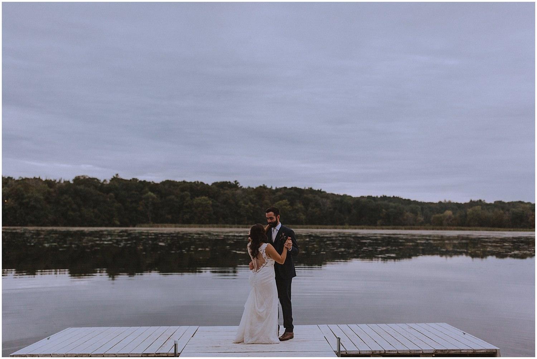 couple dancing in on a dock wisconsin wedding elopement photographer kyle szeto